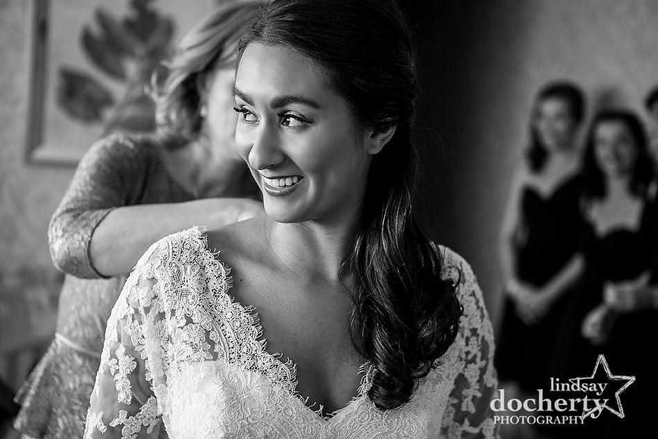 mom-helping-bride-get-in-wedding-dress-at-Wayne-Hotel